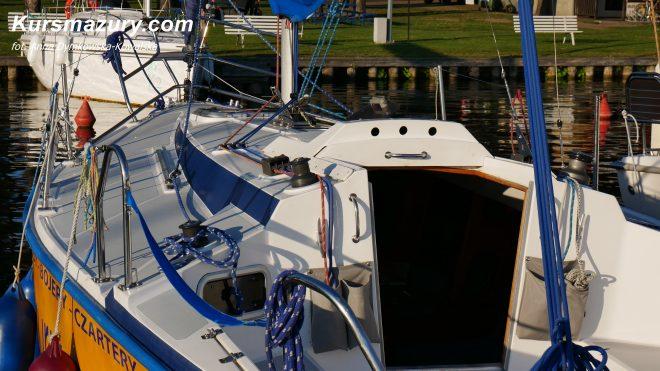 Tango 780 Sport super stan idealny jacht żaglowy kabinowy wygodny szybki zwrotny świetne wyposarzenie duży kokpit mesa wygodny duży bardzo zadbany nowe wyposażenie materace 6 osobowy Giżycko mazury wielkie jeziora mazurskie rejs czarter czartery jachtów na mazurach kursmazury najlepsze jachty dobre ceny wakacje weekend żeglarstwo żeglarz jachtowy
